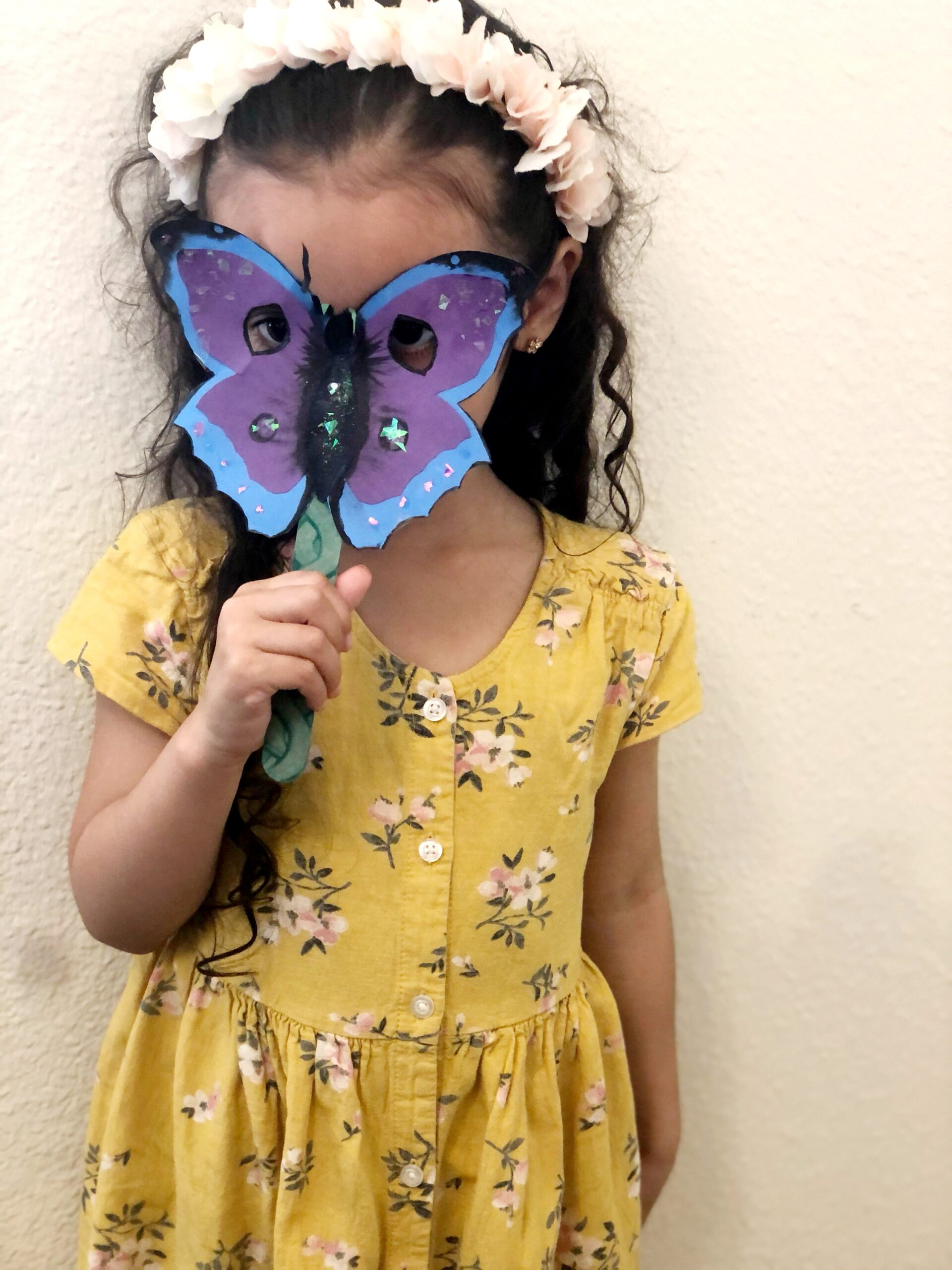 girl with butterfly mask